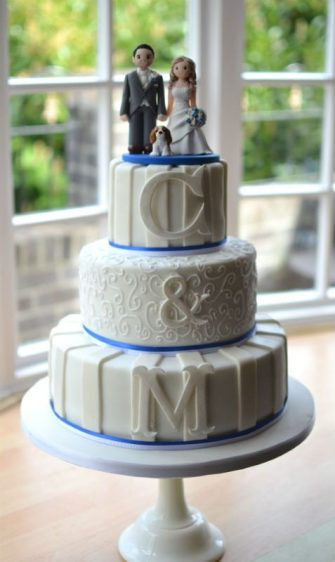 White & Ivory wedding cake with monograms. Cake topper made by Artlocke Designs