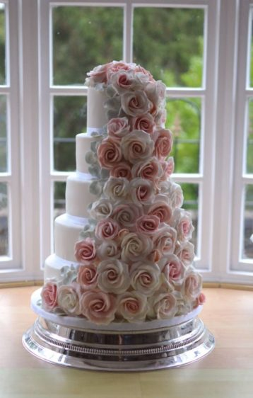 5 tier pink cascading roses delivered to Winterbourne Zelston