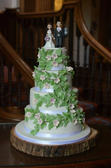 Trailing leaves wedding cake at Lainstone House