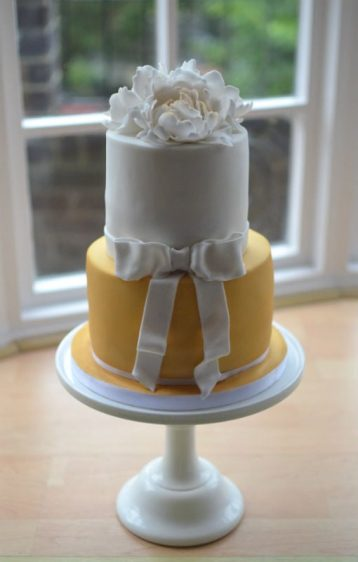 Two tier with peonies & bow cake