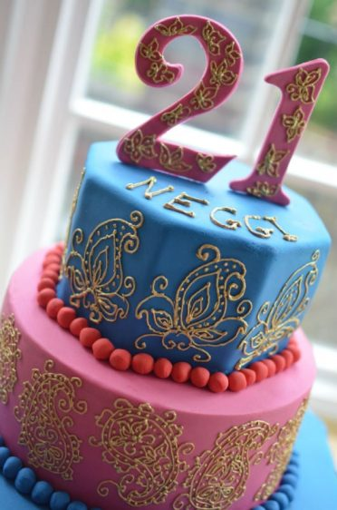 Close up of hand piped paisley birthday cake.