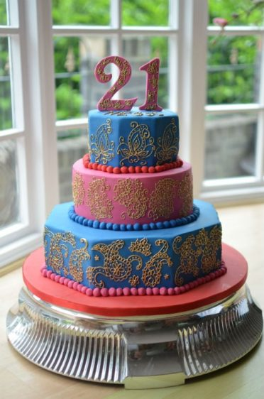 Hand piped paisley & gold design large birthday cake.
