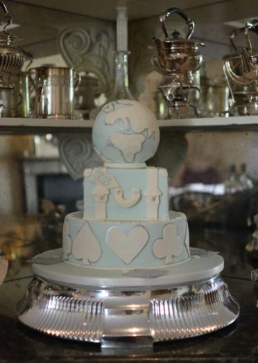 Travel & bridge players wedding cake at Summer Lodge Country Hotel