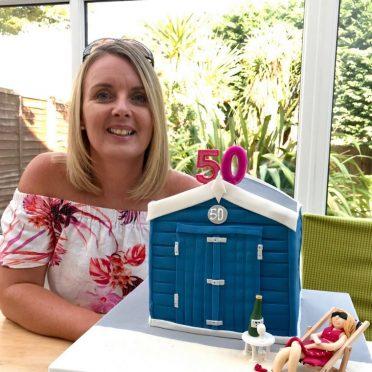 Birthday girl with her very own Bournemouth beach hut cake.