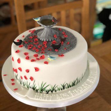 Bird bath poppy petals birthday cake