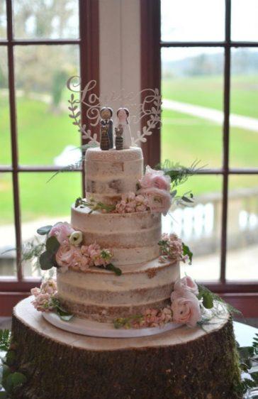 Semi-naked wedding cake at Lulworth Castle