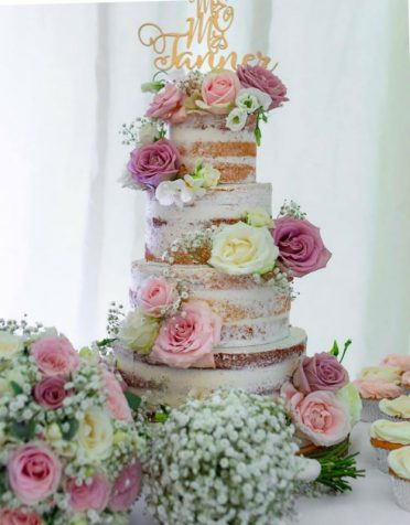 Semi-naked wedding cake Southampton. With cupcakes