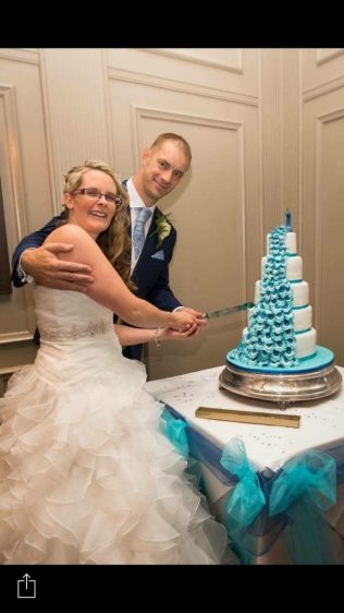 Bride and groom with their cake :)