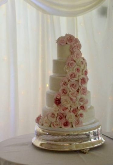 Pink cascading roses wedding cake at Parley Manor