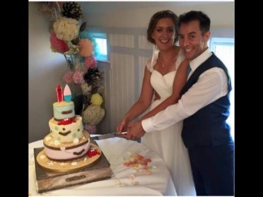 Newly weds with their cake.