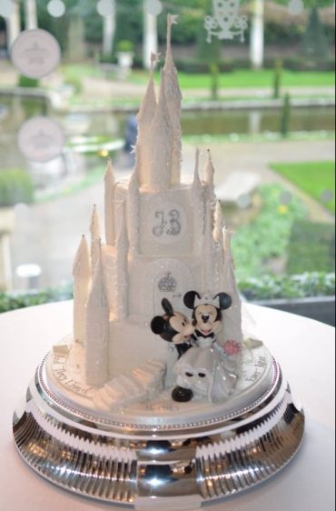 Christmas wedding. Handmade white sparkly castle wedding cake. At The Italian Villa