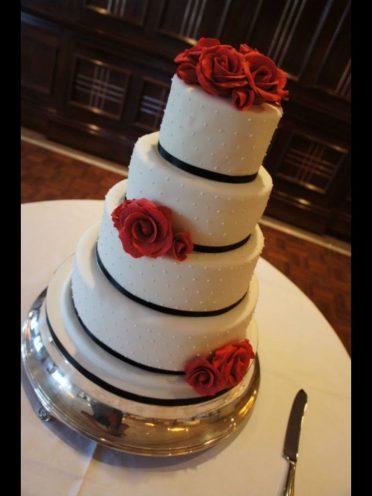Red & black wedding cake at Chewton Glen Hotel