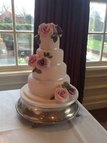 PInk dotty wedding cake at Chewton Glen Hotel