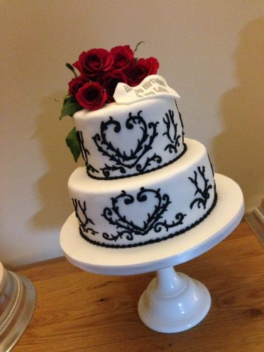 Black and white piped cake