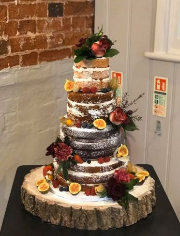 Naked wedding cake at Sopley Mill flowers by Simply Flower. Flavours from base Lemon drizzle, rich chocolate,carrot cake Victoria Sponge