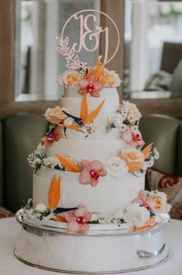 Belgian white chocolate wedding cake at The Chewton Glen Hotel. Photo by Hannahlovemorephotography