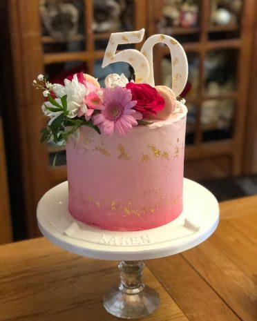 Pink gold 50th cake