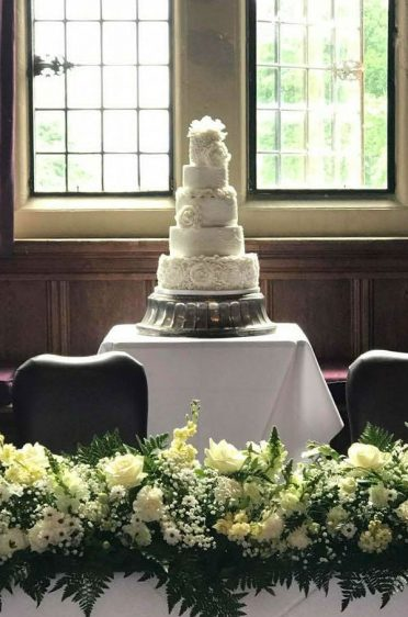 5 Tier white wedding cake at Rhinefield House