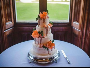 Sugar peonies & buttercream drip wedding cake at Canford Estate