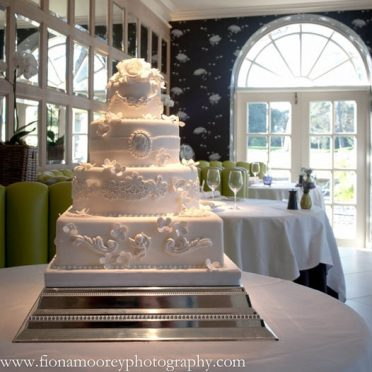 Baroque white wedding cake Chewton Glen Hotel
