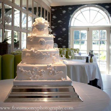 Baroque white wedding cake Chewton Glen Hotel