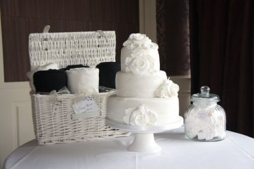 White wedding cake with marshmallows & blankets at The Chewton Glen Hotel