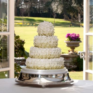 Green ruffle wedding cake The Chewton Glen Hotel