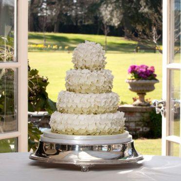 Green ruffle wedding cake The Chewton Glen Hotel