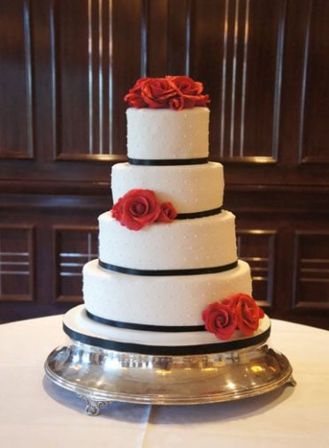 Red roses black ribbon dotty wedding cake