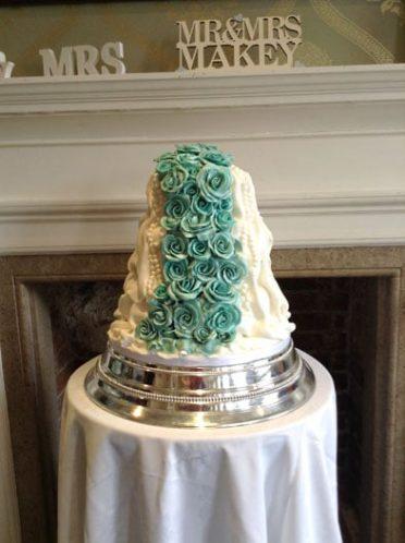 Turquoise cascading roses wedding cake