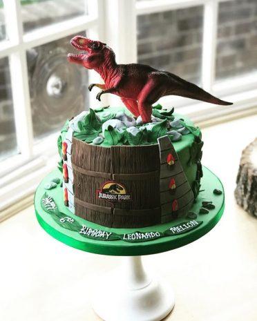 Single tier Jurassic Park cake