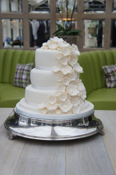 Ivory 3 tier with blossom ivory flowers at Chewton Glen Hotel