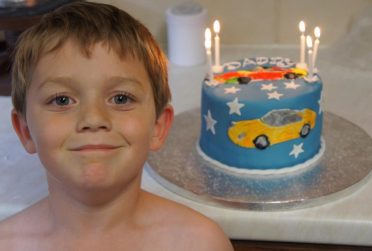 My young son feeling proud making his dads cake. 2012