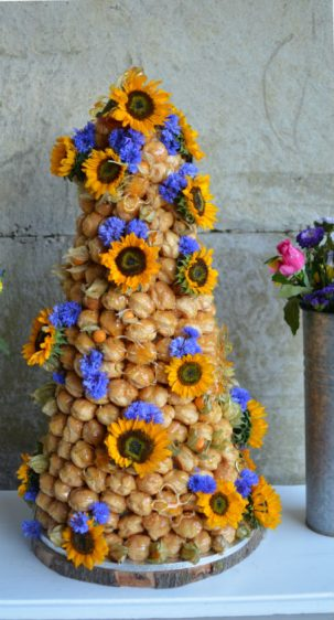 Sunflowers croquembouche for a rustic farm wedding in Dorset