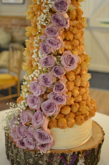 Close up of Croquembouche and lemon cake base