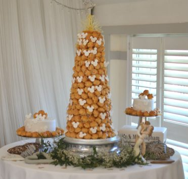 Minnie Mouse croquembouche with wedding cakes to match at The Kings Hotel