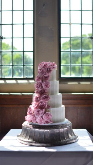 Cascading sugar roses & pannelling at Rhinefield House