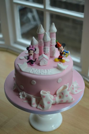 Pink Minnie Mouse castle cake