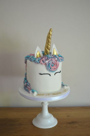 Gold unicorn cake