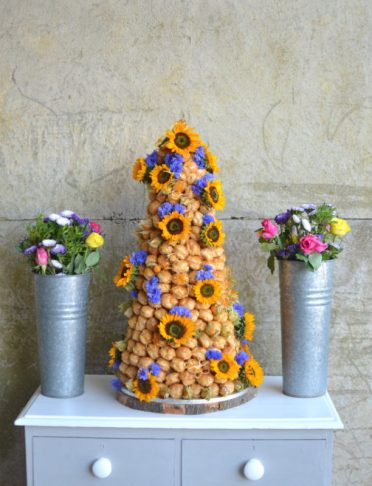 Sunflowers croquembouche for rustic farm wedding in Dorset