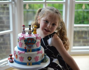Paw Patrol cake modelled by the beautiful birthday girl :)