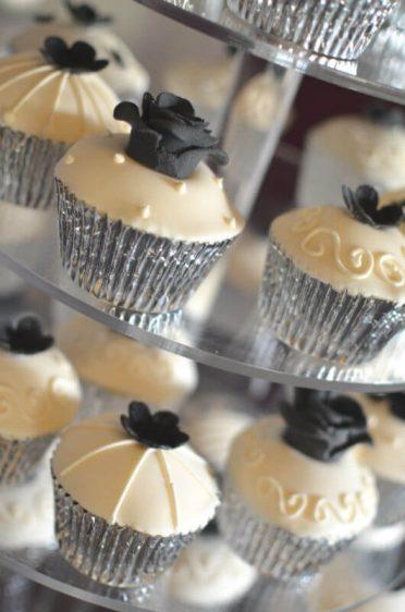 Ivory & black cupcakes.