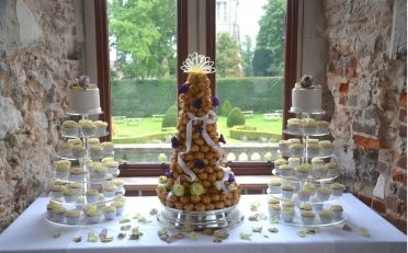 Cupcake towers with top cakes and Croquembouche.
