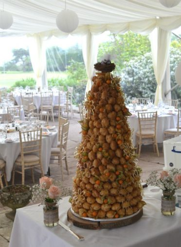 Croquembouche with brides own birds topper at Studland Bay House.
