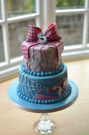 Girls pink Spiderman cake. Posted to London