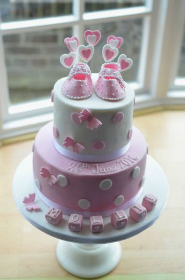 Pink spotty & booties Christening cake