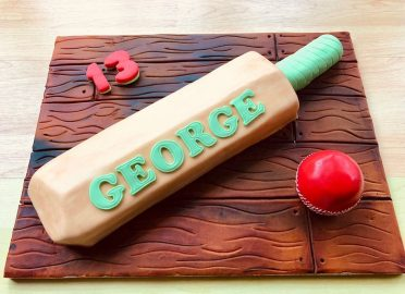 Cricket bat & ball birthday cake