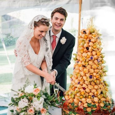 Beautiful couple with their croquembouche! Piece montee