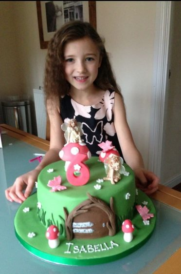 The beautiful Isabella modelling her birthday cake :)