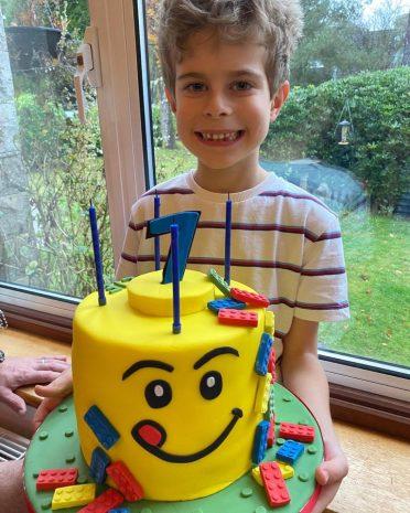 Happy birthday boy with his cake